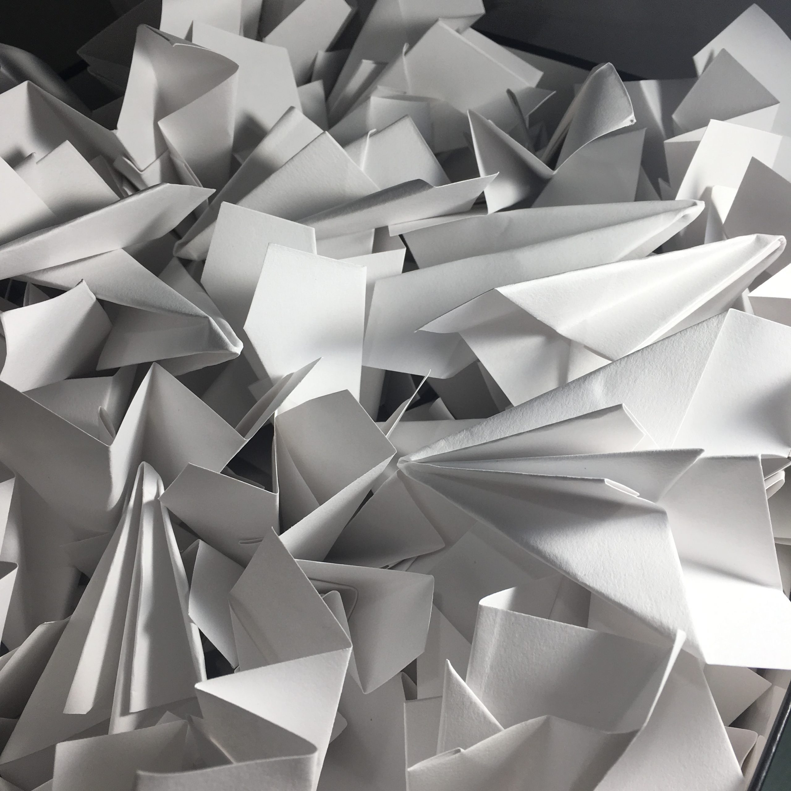 pile of paper airplanes